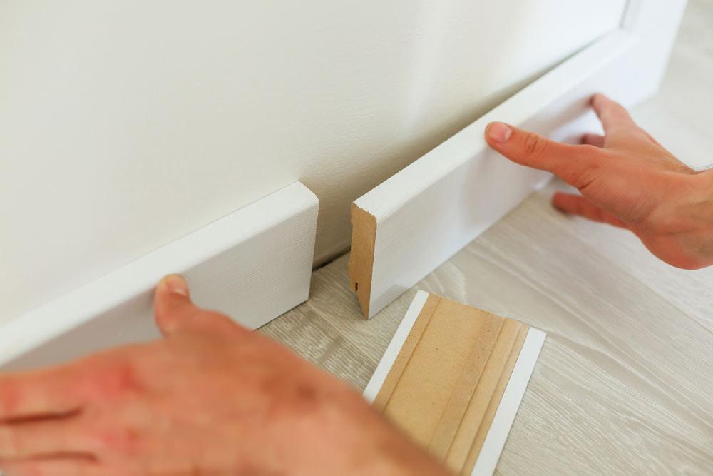 Installing Baseboard Molding on Uneven Floor