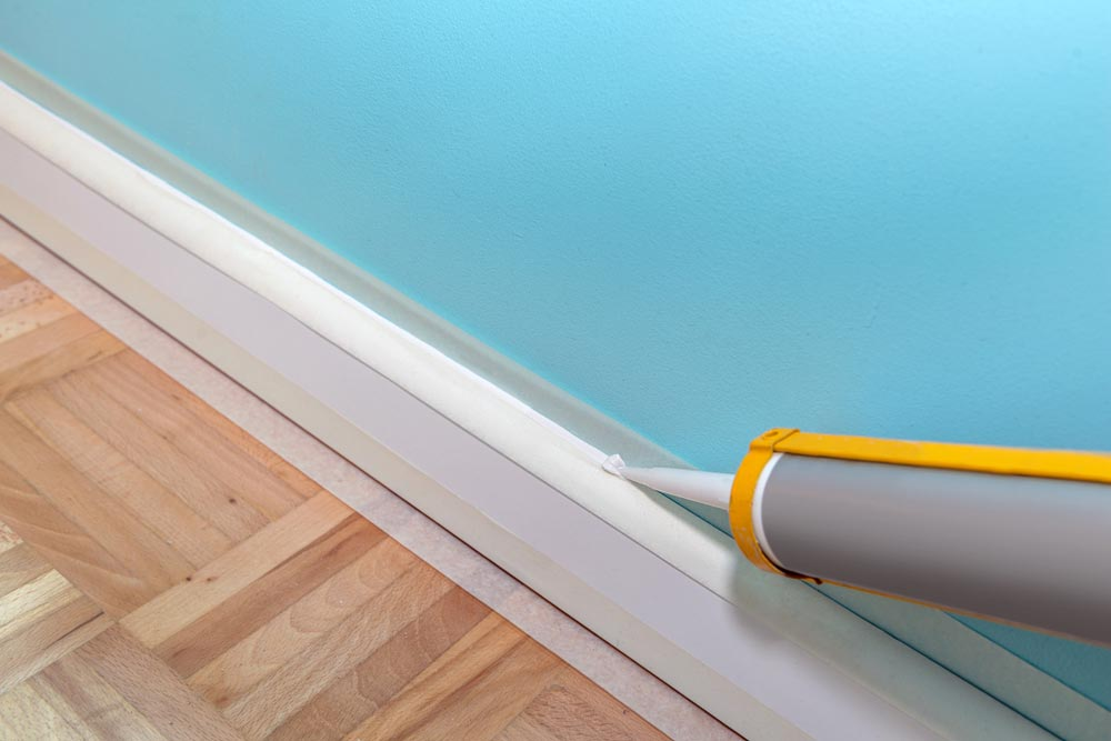 how to fix gaps in baseboard corners